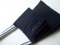 ...bag made from recycled sweaters and suits! page comes up in Italian, right click and translate to English. cute.