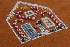 The 'snowman side' of the Candy Cane Cottage by Victoria Sampler - discussed on Janet Granger's blog