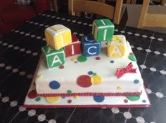 A cake made for a 1st birthday. I was told Alicia liked blocks so used it as inspiration.... I was also told to use primary colours not pink or girly! The cake is Madeira sandwiched with vanilla buttercream and jam and the blocks are rice crispie cakes which I iced. This made them light when stood on top of the cake and they were easy to carve.