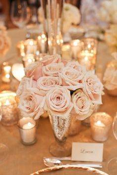 Elegant blush pink roses, classy wedding table decor with silver accents