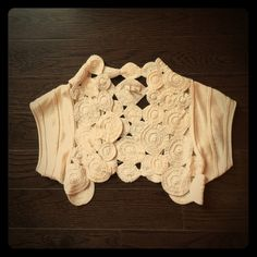 Cream shrug with a hint of sparkle A great shrug to top off any cute top!  The cream fabric is laced with delicate silver thread for a slight sparkle. Anthropologie Sweaters Shrugs & Ponchos