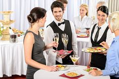 Caterers; waiter and waitress serving food and drinks