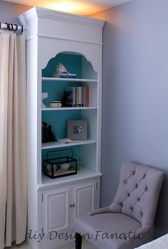 I love bookcases with a splash of color in the back (crown molding on top!)