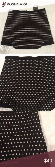 """NWT**TOPSHOP**Mini Skirt**US 6 Black and white mini skirt. Stunning black and white mini skirt. US 6; UK 8; EU 38 Zipper in the back Waist: 30"""" Length: 14 1/2"""" Zipper goes down the whole skirt in the middle of the back. Sides are a little short than the middle. This skirt is very pretty and different. Great for day or night wear and can be worn during all season!!! Topshop Skirts Mini"""