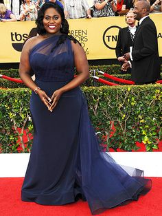 "The Night's Most Stunning Dresses | DANIELLE BROOKS | When she gets out of her Orange Is the New Black prison jumpsuit, ""Taystee"" cleans up good. The star wears a romantic dress by ""the fabulous Christian Siriano. I feel very beautiful today,"" she says."