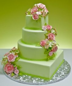 http://www.jacquespastries.com/weddingcakes/sugarfloral/files/collage_lb_image_page24_12_1.jpg
