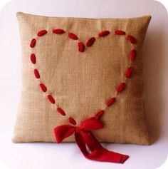 burlap pillow with red yarn heart: sweet hearts