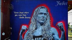 A new 20-foot-tall mural in Venice Beach is paying tribute to UFC champion Ronda Rousey.