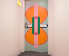 Formica® Envision™ orange pattern on door  #Formica #Envision #Design #custom #laminate