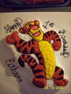 Tigger Cake: I used a shaped Tigger cake pan I found at a yard sale. It took one cake mix.  I used buttercream in orange, black. white, yellow and pink.  I also used