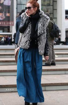 Wear a chunky fur vest with a long blue maxi skirt
