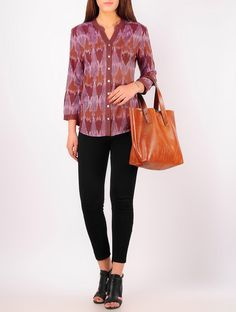 When colorful adventures come calling, slip this on for a tip-toe around town. This ikat Top is an ode to handwoven ikat textiles and has been created in collaboration with designer Sonica Kapur. The fabric for this exquisite piece has been tie-dyed by hand and then handwoven on looms by the artisans from the village of Pochampally in Andhra Pradesh.