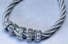 Fine woven rings: necklace, herringbone stitch, crossweave technique, square stitch.  Find more projects on BeadAndButton.com
