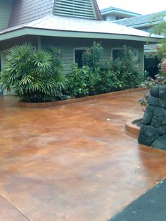 An acid-stained driveway, very classy looking, durable, adds tons of curb-appeal. Get @ Lowe's or Home Dep. Supposedly an easy DIY.