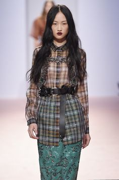 Classic tartan turned into see through organza shirting, adorned with heavy jewels and a masculine belt seen yesterday at@NUMEROVENTUNO. Edgy, unique and wearable. #MFW #SS15