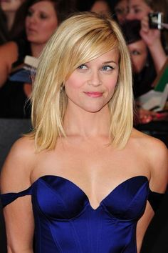 This cut is ideal for Reese and many women with fine hair; it has minimal layering and fun, flirty bangs but is still long enough to be versatile. #hairstyles #ReeseWitherspoon