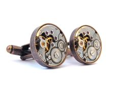 A Unique Pair of Steampunk Cufflinks  Copper Cuffs     These smart looking cufflinks feature two vintage mechanical watch movements.  Original red jewel bearings can be seen on their surfaces in amongst the beautifully contrasting gold and silver colour gears and mechanics of the watches.