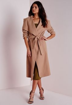 We're totally chasing waterfall this season and we got it bad for this totally chic camel coat here at Missguided. Flaunt what you got in this belted serious soft feel beaut with oversize waterfall lapel finish to make sure you step up yo...