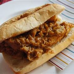 Bourbon-Mango Pulled Pork ~ Spicy, smoky, and sweet. This is the perfect addition to that crusty roll you've been trying to figure out a sandwich filling for! Crock Pot Slow Cooker, Slow Cooker Recipes, Crockpot Recipes, Cooking Recipes, Ham Recipes, Slow Cooking, Mango Recipes, Delicious Recipes, Gourmet