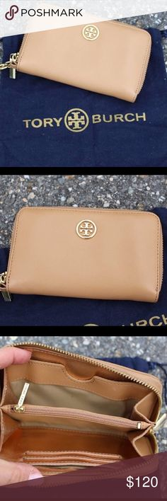 """Tory Burch York Wristlet Excellent condition Saffiano leather wallet. Golden hardware; tonal topstitching. Zip-around closure. Removable wristlet strap; 6""""L. Signature double-T logo at top center. Inside, six card slots, four slip pockets, accordion pocket with zip pocket separator. Slip compartment for smartphone (iPhone 4 or 5) Leather and fabric lining. 4""""H x 6""""W x 1""""D - price firm no trades , selling for $94.99 on www.chicboutiqueconsignments.com Tory Burch Bags Clutches & Wristlets"""