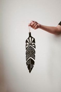 Handmade ceramic glazed feather by designer Sofia Nohlin via www.finelittleday.com