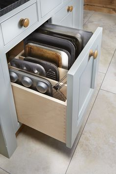 Storing oven trays on end like this makes it so much easier to retrieve the one you need. - Storing oven trays on end like this makes it so much easier to retrieve the one . Kitchen Drawer Organization, Kitchen Cabinet Storage, Kitchen Cabinets Decor, Home Decor Kitchen, Home Kitchens, Kitchen Island Storage, Kitchen Pantry Design, Kitchen Redo, Interior Design Kitchen