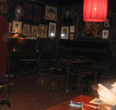 Inside Au Lapin Agile. This is the table the performers sit at.  Check out the chairs.  Basic Stagecraft projects!