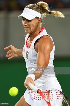 Germany's Angelique Kerber returns the ball to Puerto Rico's Monica Puig during their women's singles finals tennis match at the Olympic Tennis Centre of the Rio 2016 Olympic Games in Rio de Janeiro on August / AFP / Martin BERNETTI Angie Kerber Us Open, Australian Open, Wimbledon, Angie Kerber, Monica Puig, Angelique Kerber, Tennis Equipment, Tennis Center, Tennis Match