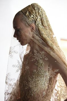 """Elie Saab Autumn/Winter 2015-2016 Haute Couture Collection gown. """"The Winter Bride. Twenty craftsmen worked on the creation of the gown that took over 600 hours to complete""""."""