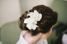 add a bit of playfulness with a gardenia in wedding updo. see more blooming #wedding hairstyles here: http://www.mywedding.com/articles/wedding-hairstyles-with-flowers/