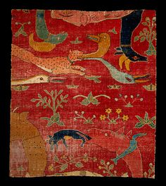 Fragment of pile carpet; wool on cotton ground, India, Mughal, c.1600. _From a lrg carpet presumed to have been made for the court of the Great Mughal Akbar. A grotesque, almost nightmarish world of animals & mythical creatures devouring one another. __The motif is not Islamic, but found in other Mughal art, & was rooted in the local Hindu art tradition. Pile carpets came to India from the north w/ Muslims. Fragments from this carpet are among the oldest that exist from the Indian subcontinent.