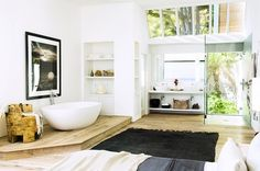 Open plan bathroom with floating tub