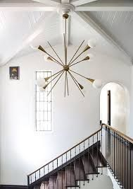 Image result for chandelier staircase mid-century