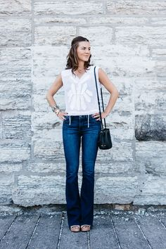 Flared jeans, embroidered top, and mini bucket bag. {love!}