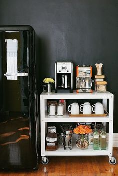Create a coffee station by organizing everything on a bar cart