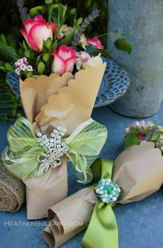 flowers wrapped in craft paper with rhinestone pins and ribbon...