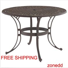 "The Metal 42"" Round Outdoor Patio Dining Table is constructed of cast aluminum with a rust brown finish and features include a hand-antiqued, powder-coat finish sealed with a clear coat. This attractively patterned tabletop has a center opening to accommodate umbrellas, and nylon glides on all legs."
