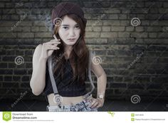 https://thumbs.dreamstime.com/z/schoolgirl-holding-cigarette-teenage-girl-trendy-clothes-standing-front-brick-wall-smoking-52514555.jpg