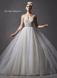 Romantic tulle ballgown, complete with sparkling beaded bodice and illusion neckline, Forsythia by Sottero and Midgley.