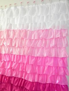 A shower curtain with oodles of fabric ruffles; diy
