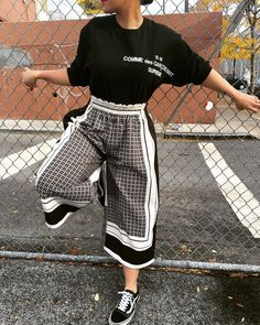 Loose fitting crop flared pants and sneakers