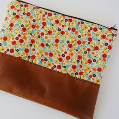 Learn this simple trick for sewing with vinyl and make this simple zippered pouch.