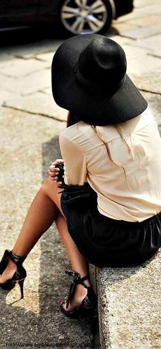 Black felt hat, peachy cream shirt/blouse, black skirt, black print strap heels, no tights or very light black tights (20 denier?)