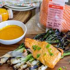 Trader Joe's BBQ Cut Fresh Atlantic Salmon Fillets have the skin left on to act as a natural barrier between the fish and the hot flames of your BBQ. Before cooking it skin-down, give it a marinade in TJ's Carrot Ginger Miso Dressing for flavorful grilled salmon without a lot of fuss.