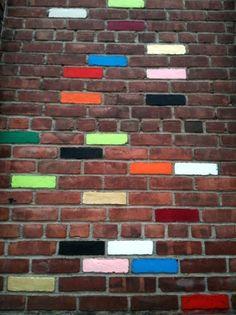 Random colourful painted brick wall.
