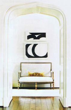 love the black and white art - maybe above the nightstands???