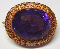 Faberge, a gold brooch set with a wonderfully coloured Siberian Amethyst.