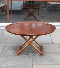 A beautiful vintage coffee table. I love the idea of adding a few round shapes to the room and some warm toned wood.