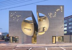 The Korean architecture firm Hoon Moon, envisioned a cultural center in the heart of the city of Ilsan, north of Seoul. The facade was engraved as a spherical vacuum and central structure was desig… Cultural Architecture, Cabinet D Architecture, Modern Architecture Design, Futuristic Architecture, Beautiful Architecture, Landscape Architecture, Interior Architecture, Landscape Design, Building Architecture