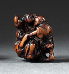 WOOD NETSUKE In the form of three blind men grabbing at each other. Height 1.5'.
